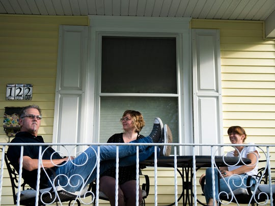 Kevin Monko (from left), Stacey Brown-Downham and Sara Neal relax on a local porch as they talk about Collingswood Porchfest.