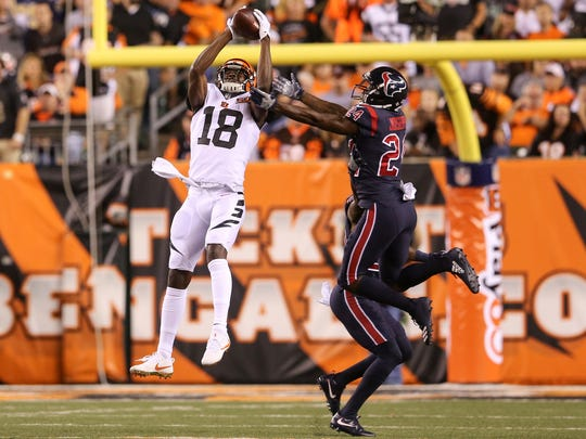 Cincinnati Bengals wide receiver A.J. Green (18) makes a catch in double coverage in the first quarter during the Week 2 NFL football game between the Houston Texans and the Cincinnati Bengals, Thursday, Sept. 14, 2017, at Paul Brown Stadium in Cincinnati.