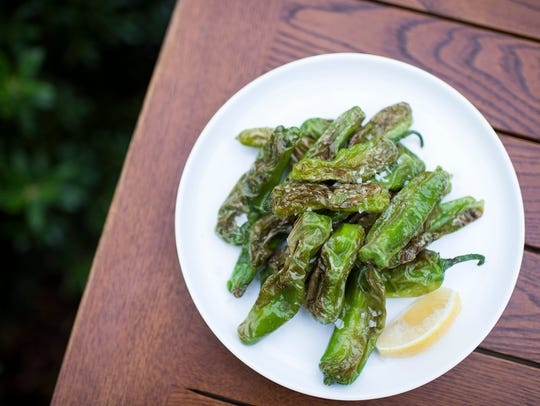 Blistered Shishito Peppers ($7.50) provide a juicy counterpoint to the richness of the meat. Served lightly browned with a little lemon, they are satisfying in their simplicity at Barcelona Wine Bar.