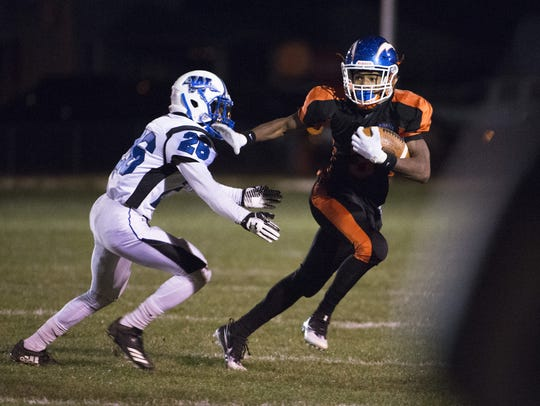 Millville's Cartier Gray (3) carries the ball against