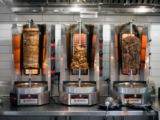Vertical broilers cook the meat for gyros inside Yeeroh