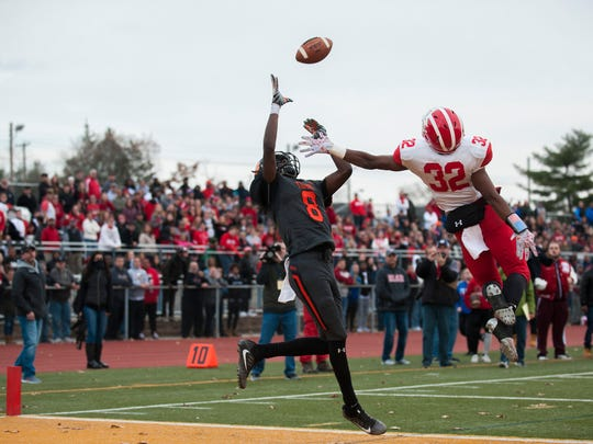 Delsea's Khaliel Burnett (32) breaks up a pass in the end zone intended for Woodrow Wilson's Stanley King (8) during a South Jersey Group 3 title game Saturday, Dec. 2, 2017 at Rowan University in Glassboro, New Jersey. Delsea won 29-28.