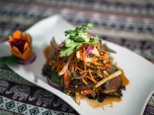 A crispy duck salad throws off some heat at Pinto Thong Thai Cuisine in Deptford.