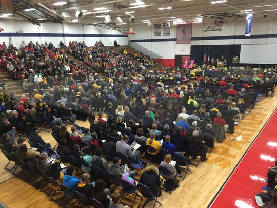 Family and friends of the Sharp family gather for their funeral at Southwestern Community College on Saturday, March 31, 2018, in Creston. Kevin, Amy and their two children were found dead while on vacation in Mexico.