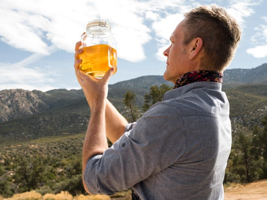 Kurt Cyr makes his own gin on his Makerville property in Mountain Center, Calif.
