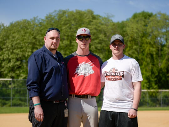 Rich Myers' sons Ryan Myers, 32, from left, Greg Myers,
