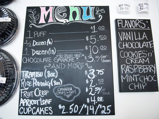 The menu inside Chloe's Créee Puffs in Pitman offers an array of flavors, as well as other treats.