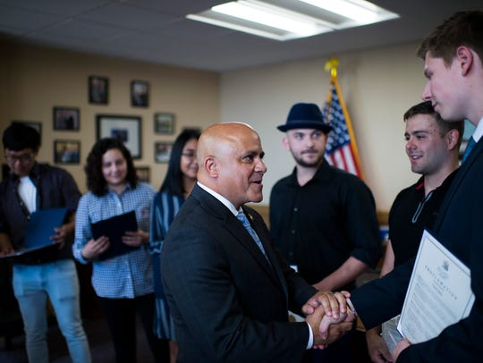 Camden Mayor Frank Moran thanks Rutgers graduate Corey Zytko inside his office Tuesday, June 12, 2018 at City Hall in Camden. Zytko, along with five fellow students rescued a man from a house fire in March 2018.