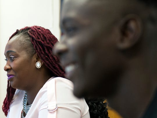 Eliza Twegby, left, smiles alongside her son Gemel Tutu, 19, Friday, June 15, 2018 at Vineland High School in Vineland, N.J. Twegby left their home in Liberia when Gemel was 3 in hopes for a better life. Gemel came to the United States as a sophomore in high school.
