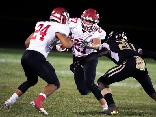 Jake Topolski (27) rushes the ball against Burlington