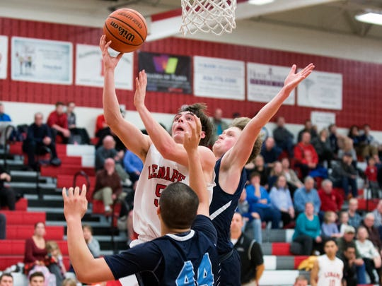 Lenape's Jake Topolski (5) drives to the basket in a game against Shawnee Tuesday, Jan. 31 at Lenape High School in Medford. Lenape won 65-61.