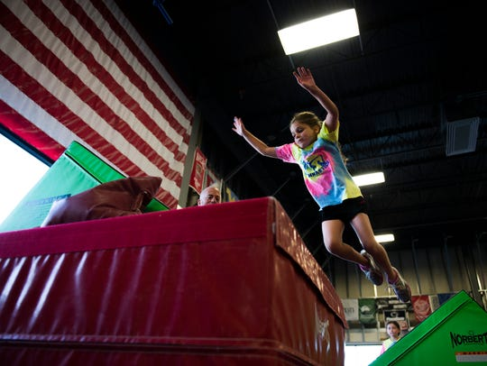 Sophia Marone, 6, leaps for a platform while participating