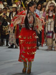 A dancer takes part in the grand entry to the Gathering