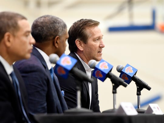 New York Knicks head coach Jeff Hornacek, far right, speaks during a press conference to announce the hiring of general manager Scott Perry, far left, with president Steve Mills, center, at the Knicks Training Facility in Tarrytown, NY on Monday, July 17, 2017.