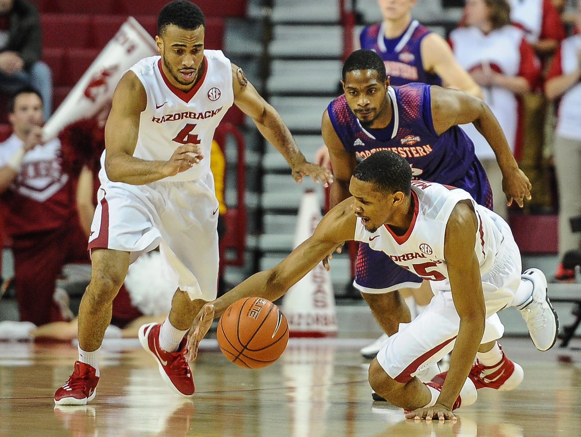 Arkansas forward Keaton Miles (55) dives for a loose ball during a game between Arkansas and Northwestern State on Tuesday.