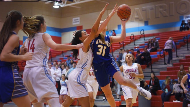 O'Gorman's Emma Ronsiek goes against Lincoln defense during the game at Lincoln Friday, Jan. 26, at Lincoln.