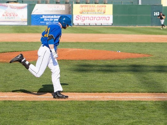 Ty Morrison (21) runs towards first base during an