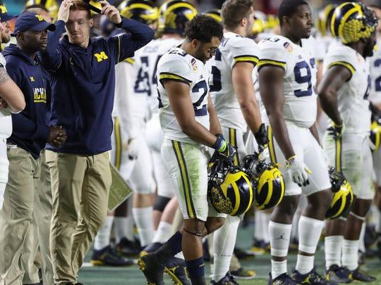 Michigan walks off the field after U-M's 33-32 loss