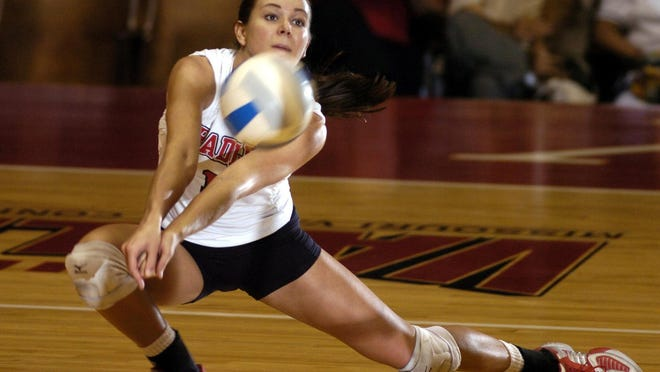 Lindsay Stalzer reaches for a return during her volleyball career at Bradley. The Kewanee graduate, 35, has excelled during her stint with Philippines Super Liga, a professional volleyball league.