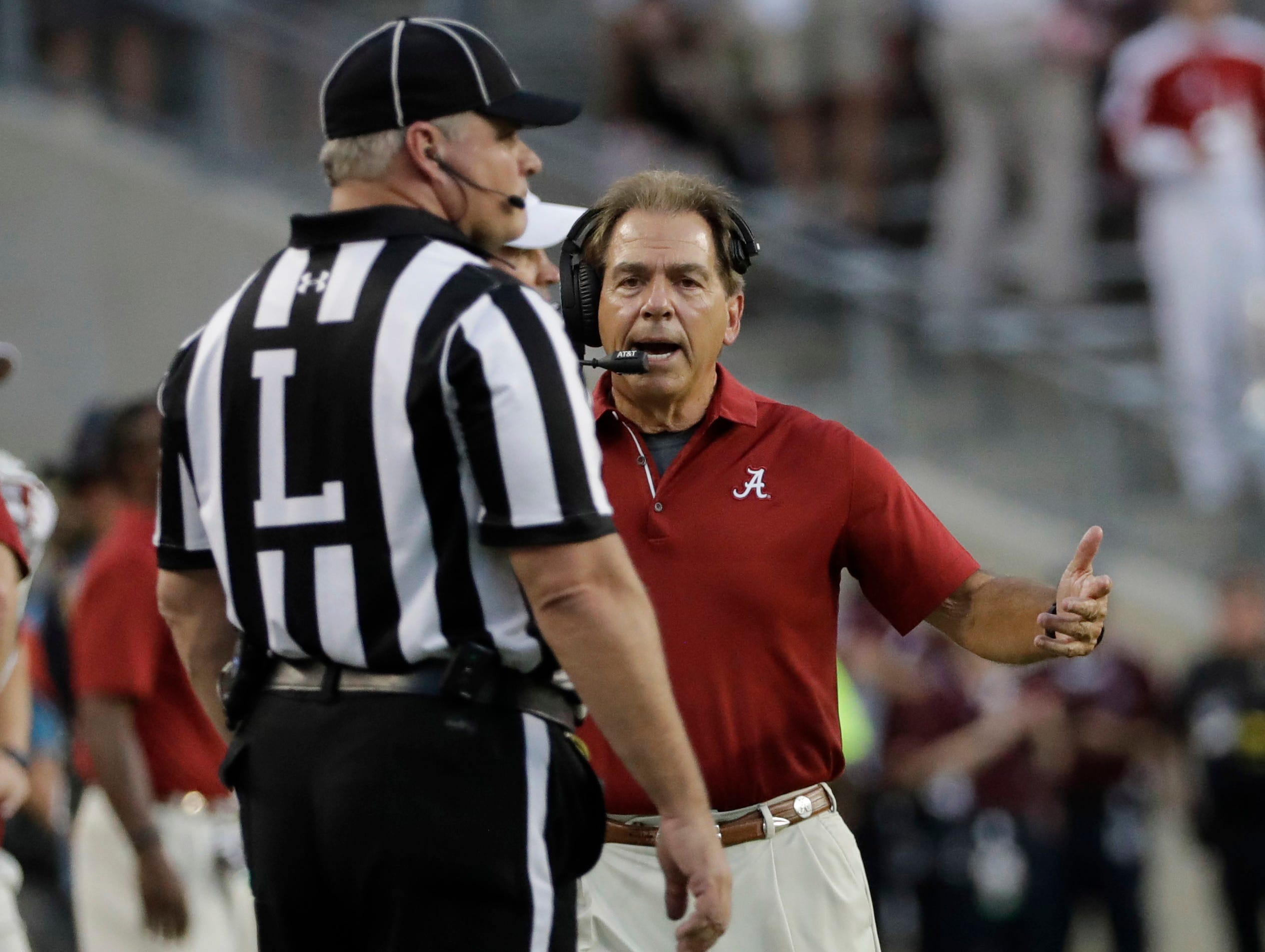 Alabama coach Nick Saban yells to an official during the first quarter of an NCAA college football game against Texas A&M Saturday, Oct. 7, 2017, in College Station, Texas.