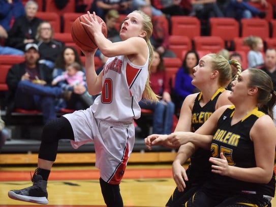 Norfork's Macy Dillard goes up for a layup against