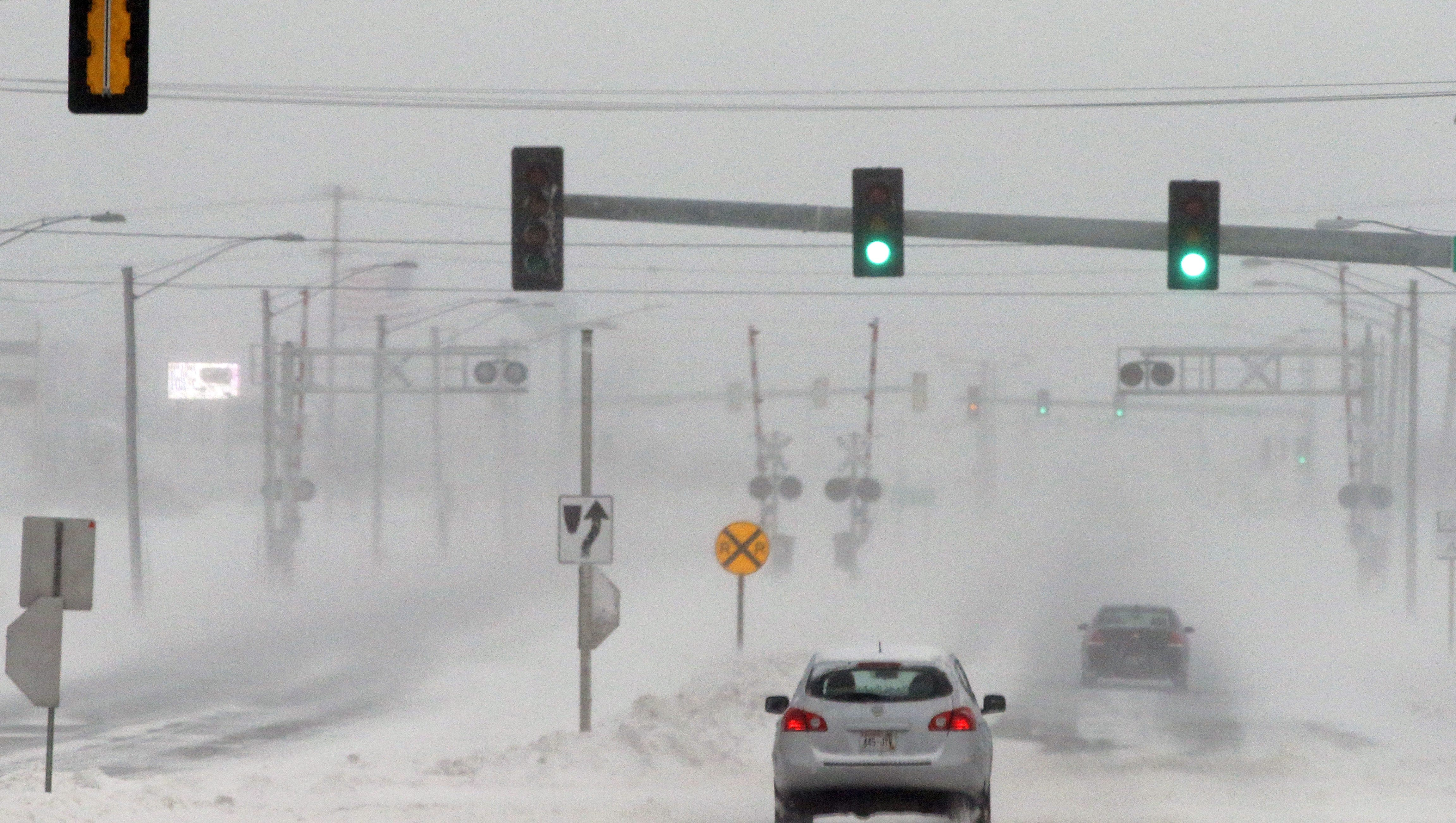 wisconsin weather  storm brings monday cancellations in