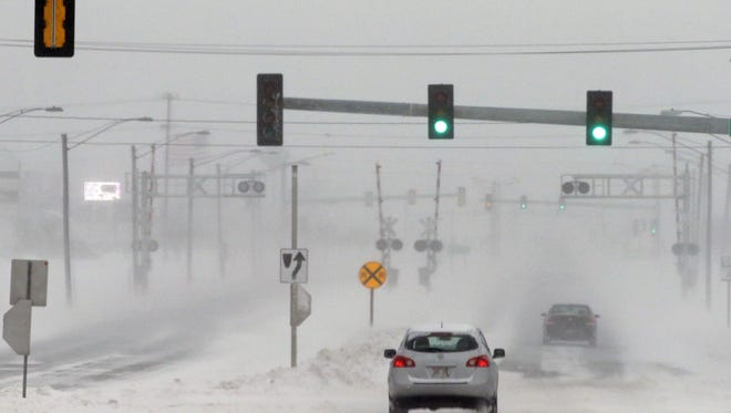 The weekend storm is shutting down numerous schools and offices across the Fox Valley on Monday.