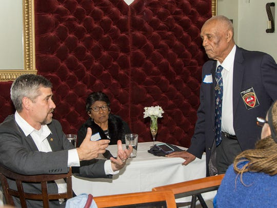 World War II veteran Jordan J. Corbett speaks with Rep. Jimmie T. Smith about their experiences serving in airborne units at a dinner on Wednesday.