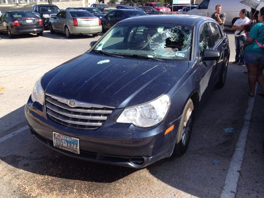 Woman breaks windshield to rescue baby from hot car
