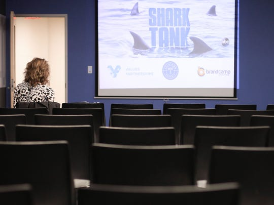 Judy Gatlin from Canton reviews her material as she waits for other business people to arrive at the Shark Tank invite-only casting call on Wednesday.