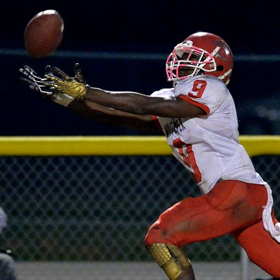 Waggener wide receiver Jairus Brents reaches for the