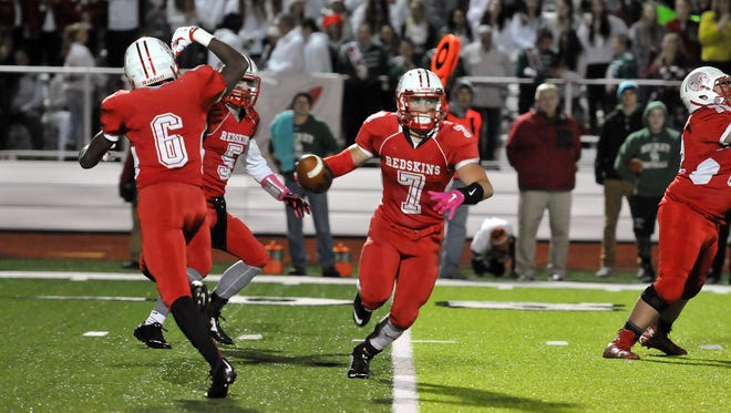 Port Clinton runs a misdirection play against Oak Harbor on Friday. The Redskins are headed to the postseason for the second straight season and second time in program history.