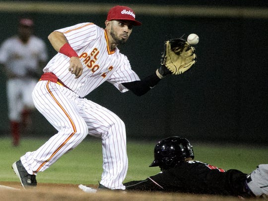 El Paso Chihuahuas second baseman Carlos Asuaje gets the throw as Raimel Tapia of the Albuquerque Isotopes arrives at second Wednesday night at Southwest University Park. Tapia then attempted to steal third base but was picked off by Chihuahuas third baseman Diego Goris. The Chihuahuas wore the retro El Paso Diablos uniforms.