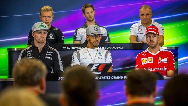 Formula One drivers Kevin Magnussen (from left to right, starting top left) of Renault, Romain Grosjean of Haas F1 Team, Valtteri Bottas of Williams, Nico Hulkenberg of Sahara Force India F1 Team, Lewis Hamilton of Mercedes AMG GP and Sebastian Vettel of Scuderia Ferrari attend a news conference Thursday at the Circuit of the Americas, in Austin, Texas. The U.S. Formula One Grand Prix is set for Sunday.