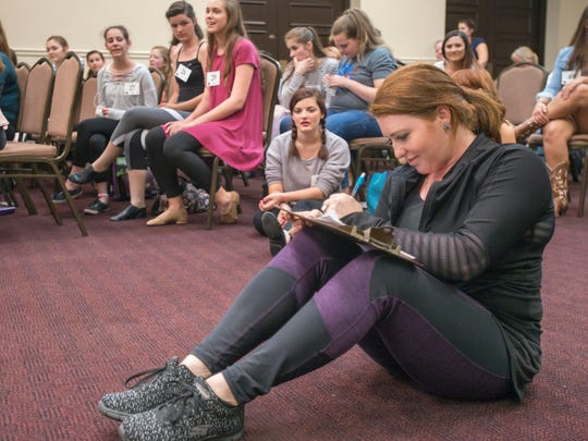 Choreographer Lexi Langston takes notes during auditions for the Footloose musical at the Pensacola Cultural Center in Pensacola on Monday, April 3, 2017.