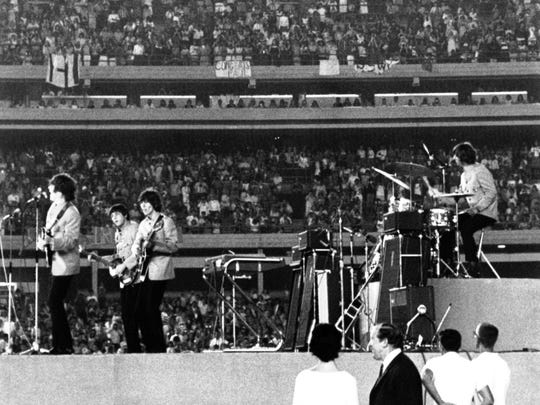 The Beatles perform at New York's Shea Stadium on Aug. 16, 1965, as about 50,000 fans cheer them on.