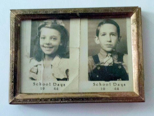 In this May 9, 2018 photograph, retired carpenter and painting contractor Frank Gilliam and his wife, Edwina, both 84, have displayed wallet-size school photographs showing them in 1944. They reunited at a class reunion about 35 years after high school and will soon celebrate their 25th anniversary. (Luisa Porter/The Commercial Dispatch via AP)