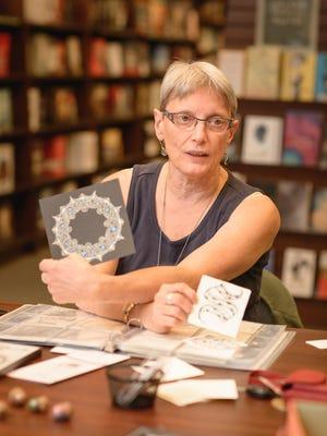 Sharon McKenney displays some of her Zentangle pieces.