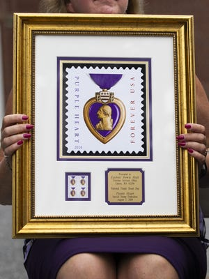 Purple Heart stamps set in a purple and golden frame were presented to the guests of honor at the last year's National Purple Heart Day observances in Easton on Wednesday, Aug. 7, 2019.
