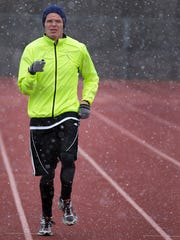 In this file photo, Jason McElwain runs at the Greece Athena High School track.