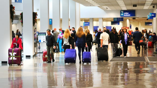 Holliday travelers come and go at the Salt Lake City International Airport on Monday, Nov. 21, 2016.