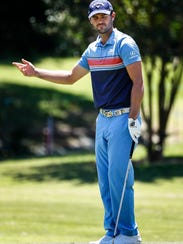 Golfer Wesley Bryan reacts after missing a putt on