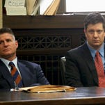 Chicago police officer Jason Van Dyke, right, charged with murder in the 2014 videotaped shooting death of black teenager Laquan McDonald, sits in court with his attorney, Dan Herbert, at the Leighton Criminal Court Building in Chicago on March 23, 2016, for a status hearing in his case.