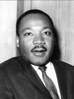 US clergyman, civil rights leader and future Nobel Peace Prize winner Martin Luther King speaks in September 1964 in London.