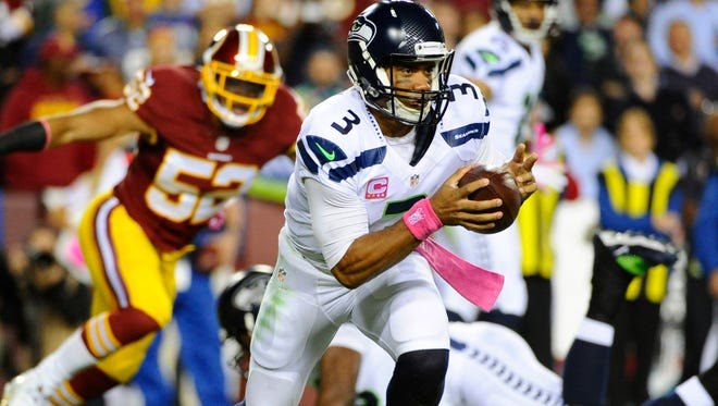 Seahawks QB Russell Wilson rushed for a career-best 122 yards Monday.