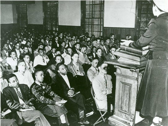Martin Luther King Jr., third from left, front row,