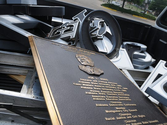 A pickup at Alabama State University is loaded with plaques and letters used in Joe L. Reed's name outside the Acadome after the ASU Board of Trustees voted to remove Reed's name from the Acadome sports arena on the campus in Montgomery, Ala., Friday, May 30, 2008.