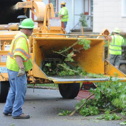 Richmond Street Department personnel work to clear