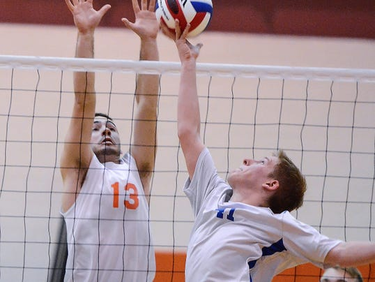 Northeastern's Matt Thornton attempts to block Cocalico's Garrett Strunkin a District 3-AA boys' volleyball semifinal match on Wednesday. Northeastern rolled to a 3-0 victory.