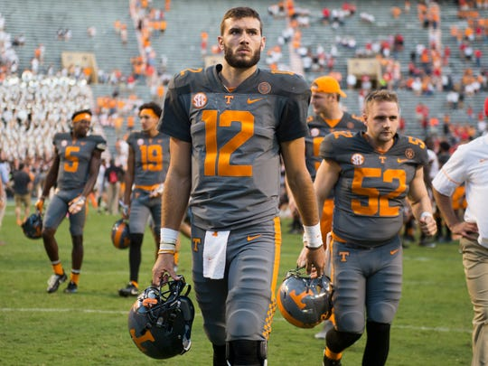 Vols quarterback Quinten Dormady (12) walks off the